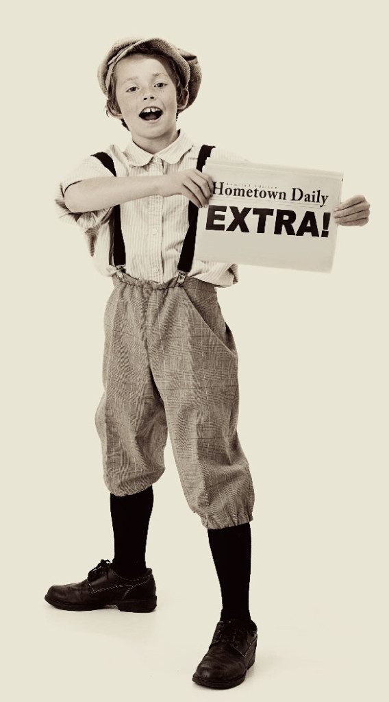 Newsboy with vintage newspaper